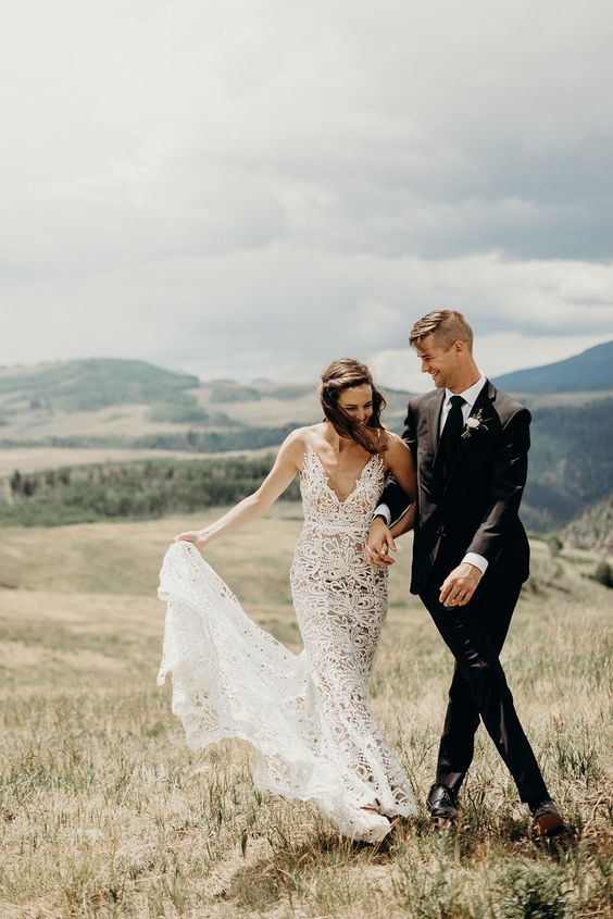 a lace spaghetti strap mermaid wedding gown with a V-neckline and a small train