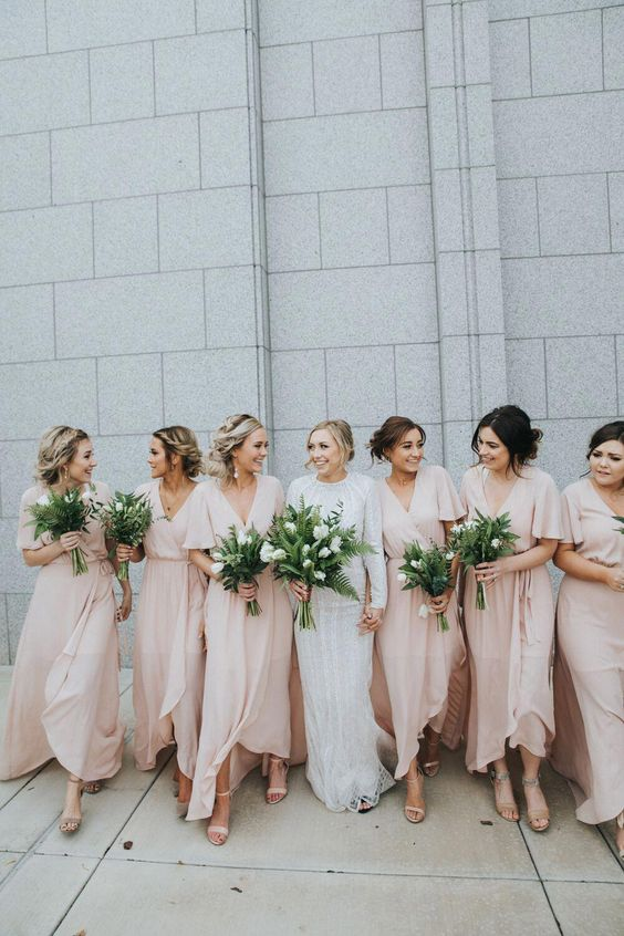 tender blush wrap maxi bridesmaid dresses with high low skirts, V-necklines and short sleeves