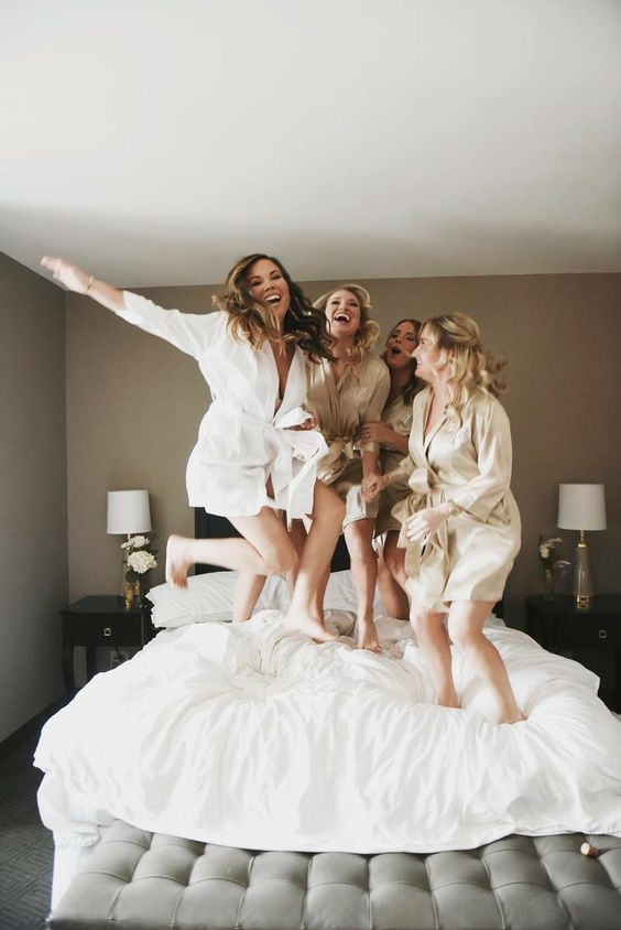 a bride having fun with your gals while getting ready for the ceremony is an awesome idea of a wedding photo
