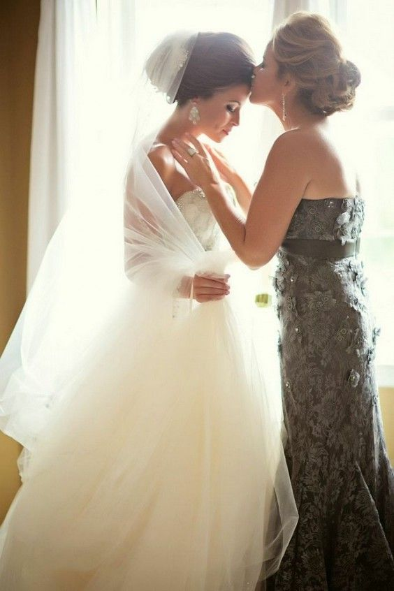 mother blessing her daughter before the wedding ceremony - this is a gorgeous shot to take in the morning