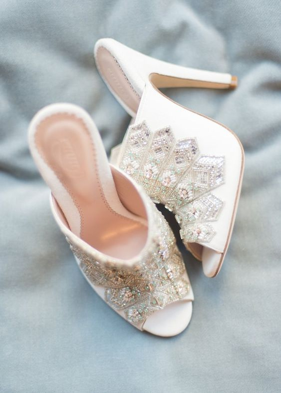 white heavily embellished mules for a fashion-forward bride who wants a touch of bling