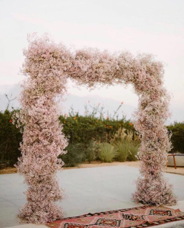 a beautiful blush cherry blossom wedding arch is a gorgeous spring idea to try