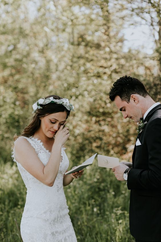 the emotional moment reading each other's vows during the first look is a very romantic time