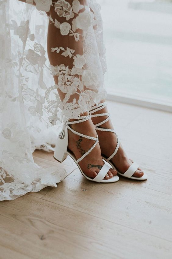 white strappy block heels with tassels are a cool boho idea for a summer or tropical wedding