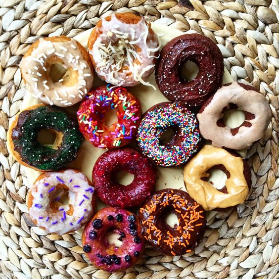 vegan donuts with colorful glaze and sprinkles are colorful, fun and whimsy for a vegan wedding