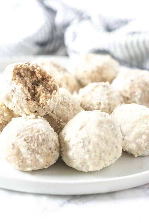 vegan gluten free Mexican wedding cookies are sugar-coated pecan balls with almond and vanilla