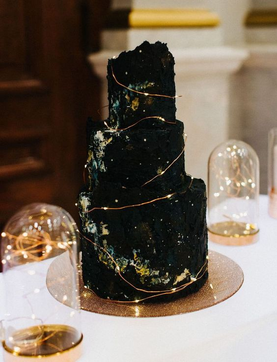 a black celestial wedding cake with lights is a real masterpiece, not just a wedding dessert