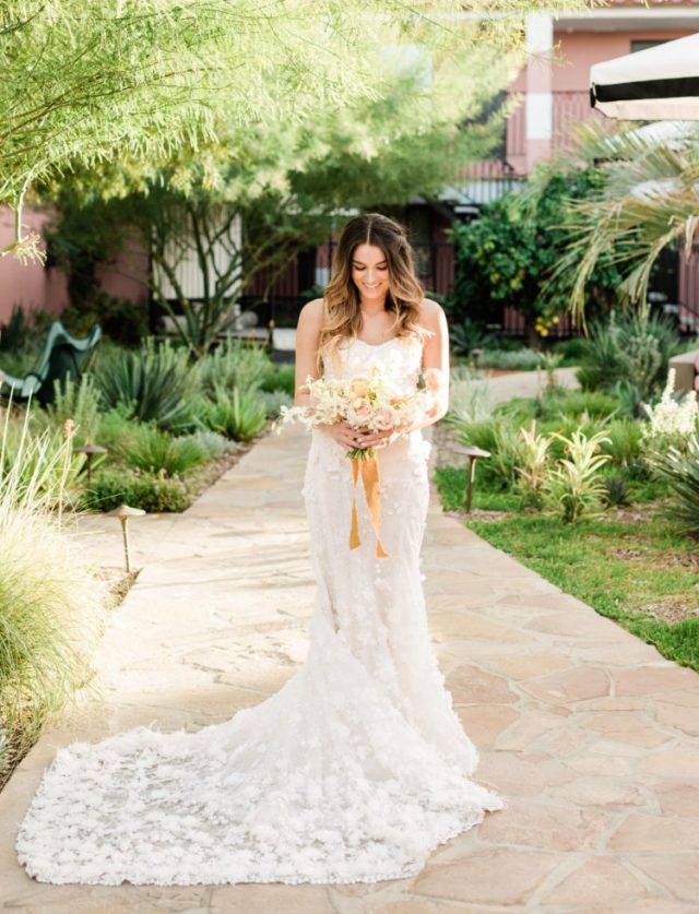 One bride was wearing a strapless floral applique mermaid wedding dress with a train