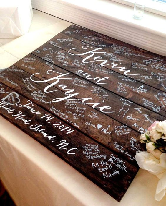 a reclaimed wooden sign with your names and lots of wishes from the guests to be used as an artwork
