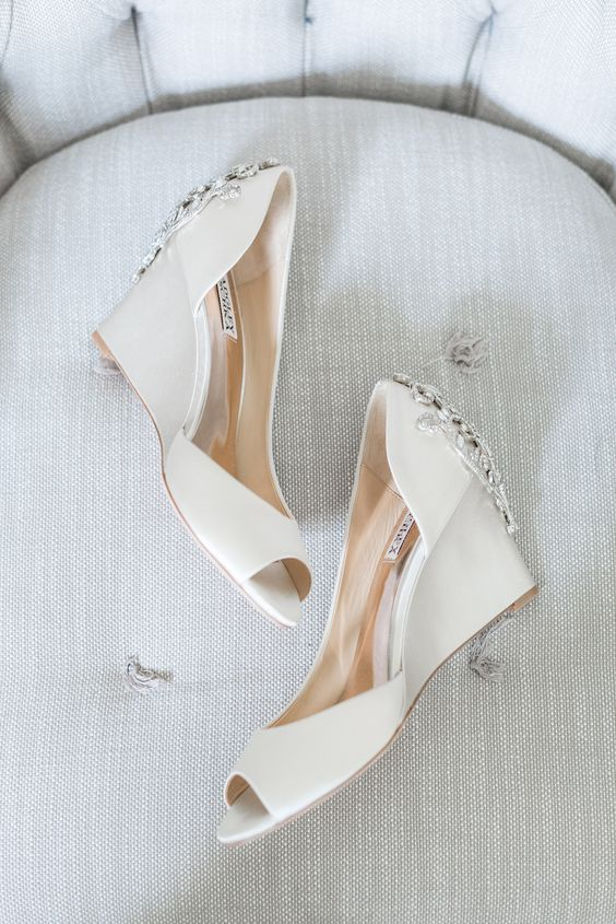 white wedding wedges with peep toes and heavily embellished backs by Badgley Mischka
