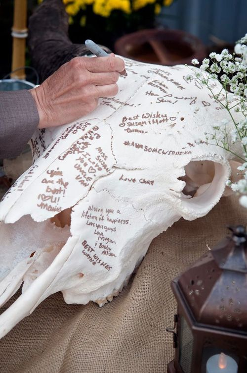 a faux animal skull as a guest book will fit not only a rustic but also a woodland or boho wedding