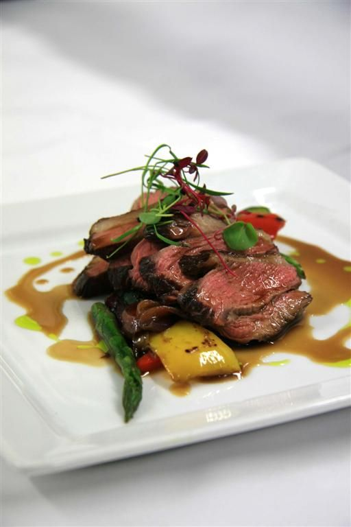 chargrilled lamb with fresh sprign veggies and herbs on top is a cool idea for a spring wedding
