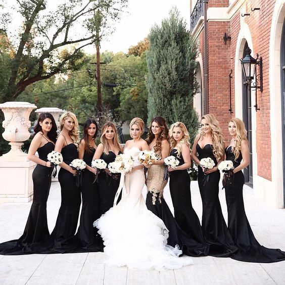 sexy black spaghetti strap mermaid bridesmaid dresses with trains and a strapless mermaid dress with gold sequins on the bodice and a black skirt