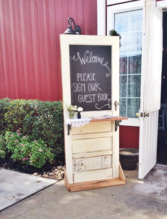a rustic meets vintage wedding guest book - a vintage door that is to be signed and decorated by the guests