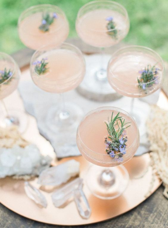 fresh lemonade with some edible flowers and herbs is sure to be a perfect sprign wedding signature drink