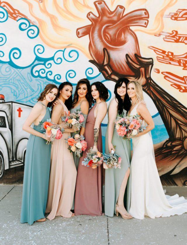 The bridesmaids were rocking mismatching pastel gowns