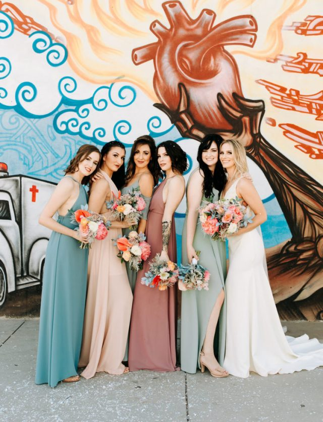 The bridesmaids were rocking mismatching pastel gowns
