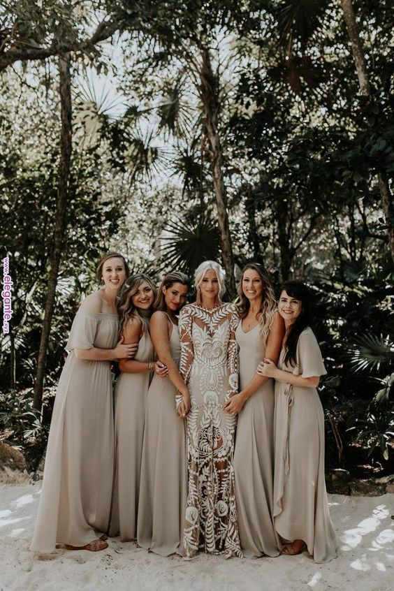 mismatching off white maxi bridesmaid dresses are right what you need for a trendy tropical wedding