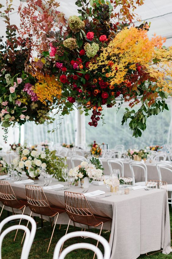 a super lush and super bright floral installation over the reception tables will make a gorgeous statement