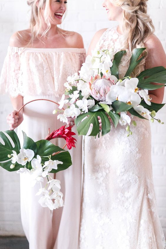 mismatching floral applique maxi bridesmaid dresses in white are a very elegant option