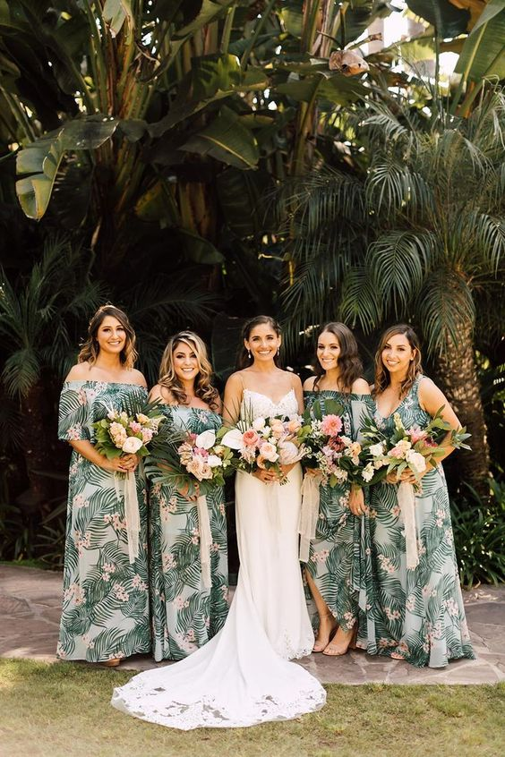 mismatching tropical print maxi bridesmaid dresses with straps and off the shoulder necklines