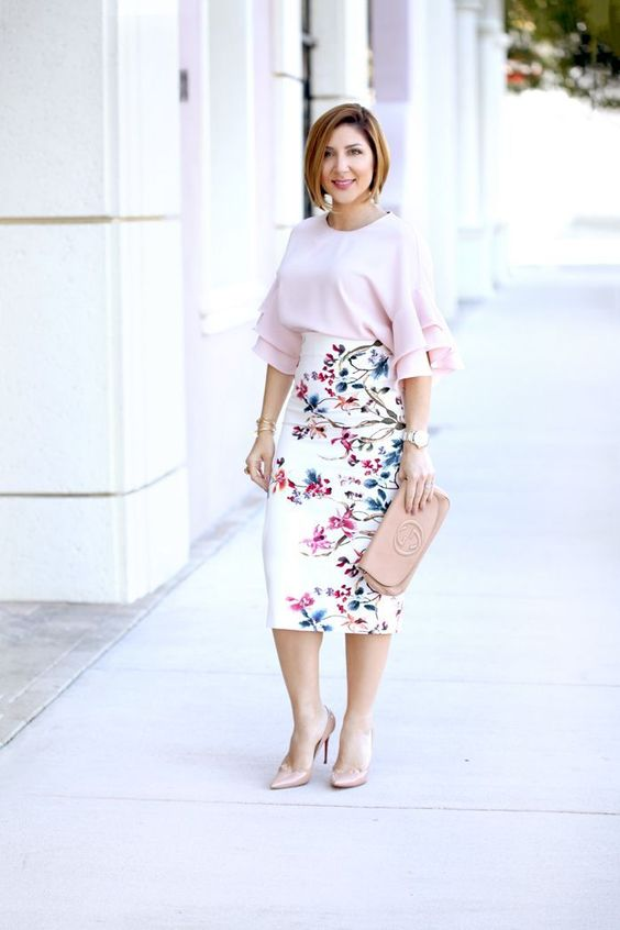 a spring wedding guest look with a blush blouse with ruffled sleeves, a high waisted floral pencil skirt, blush shoes and a blush clutch