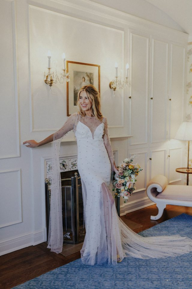 The bride was wearing a fantastic wedding gown with pearls by Rue de Seine