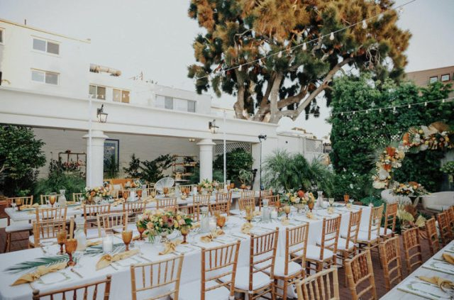 The wedding tables were dressed up with amber and yellow plus lush yellow and blush florals