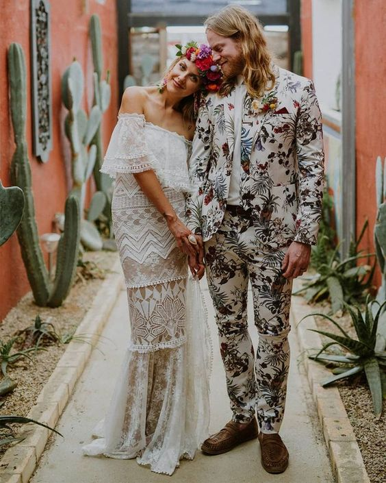 a bright floral print suit and a matching tie, a white shirt, brown loafers for a tropical groom's look