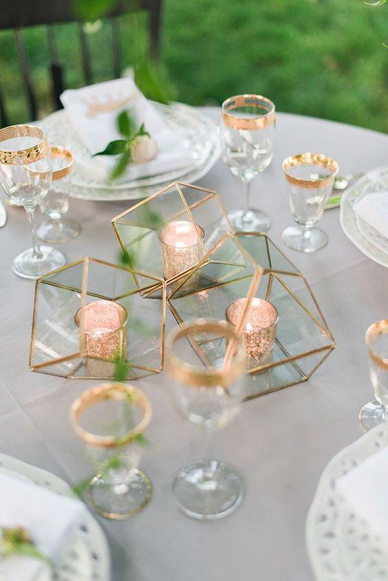 a minimalist wedding centerpiece made of geometric gilded terrariums with candle holders inside is a chic and bold idea