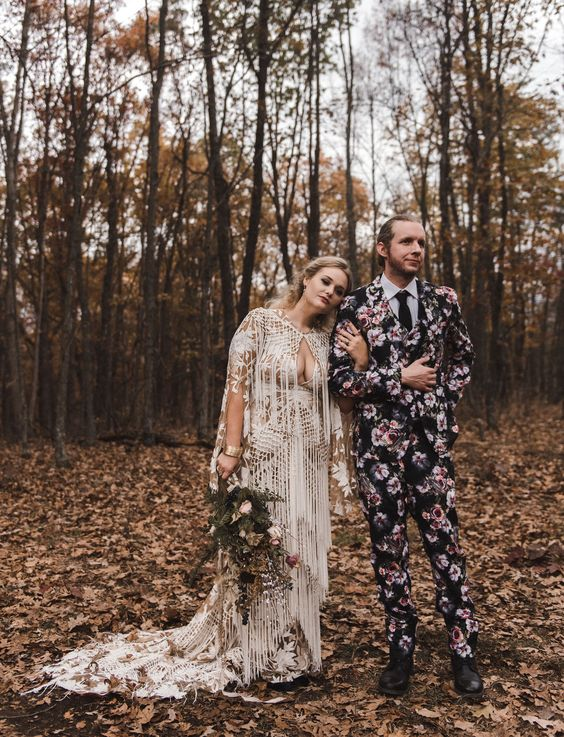 a moody floral print three-piece wedding suit, a black tie and a white shirt, black shoes