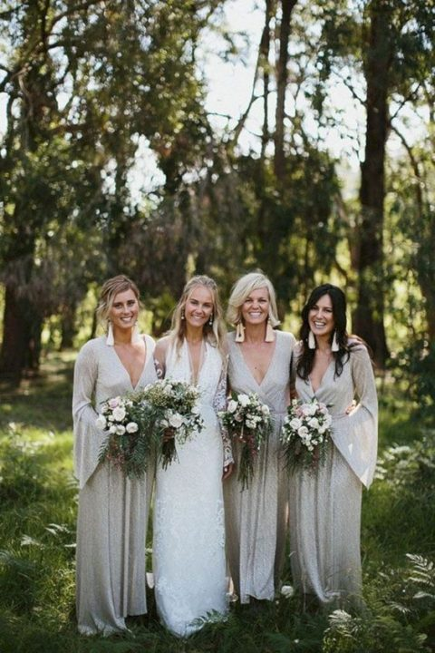 beautiful silver embellished wrap maxi bridesmaid dresses with bell sleeves and statement earrings