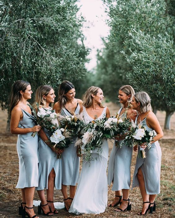 light blue slip midi dresses paired with black shoes for a romantic spring or summer bridesmaid look