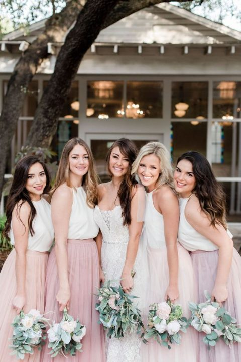 white halter neckline tops and mismatching blush, light pink and lilac maxi skirts