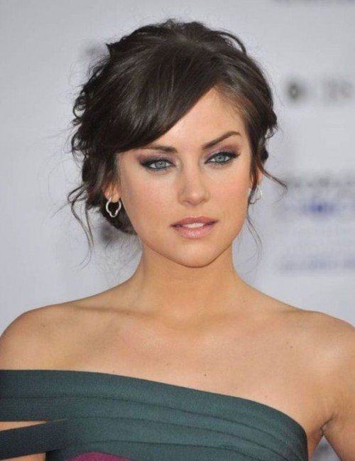 a wavy updo with side bangs is a chic and elegant idea that works for medium and long hair