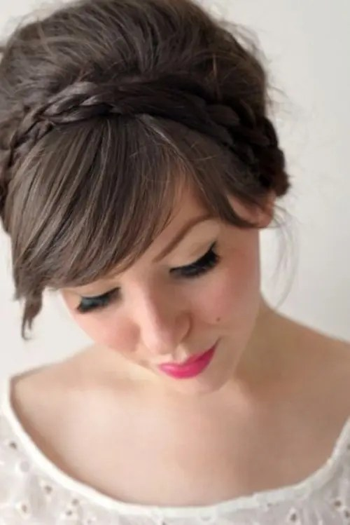 a top knot with a braid and full fringe bangs is great to pull off bold and sexy bridal style with a touch of retro
