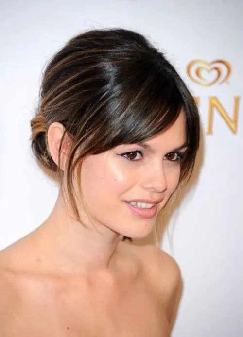 a low updo on medium length hair with side bangs is a cool idea to pull off an elegant look