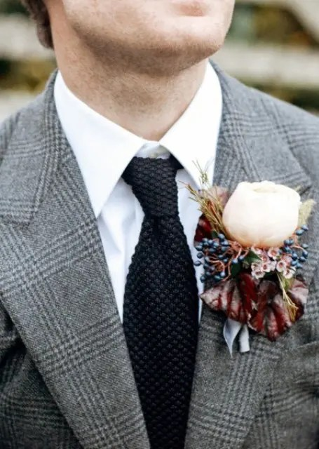 a grey tweed checked suit, a white button down, a black tie and a floral and berry boutonniere to refresh the look