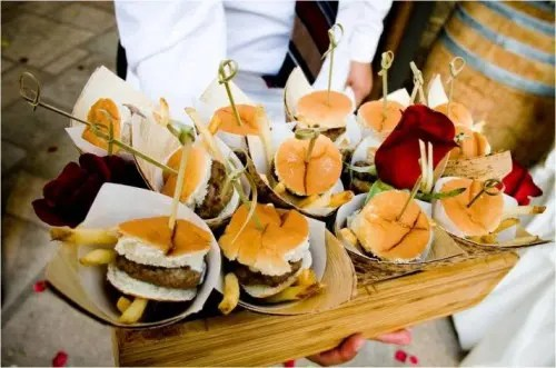 mini burgers with French fries by their side is a casual appetizer option for any wedding