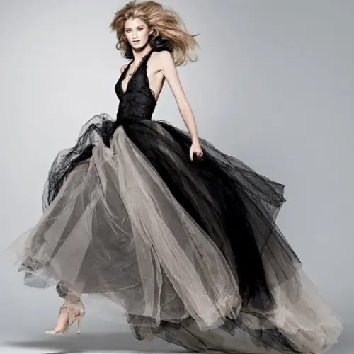 a whimsy black and neutral wedding dress with a full skirt, a fitting black bodice with straps