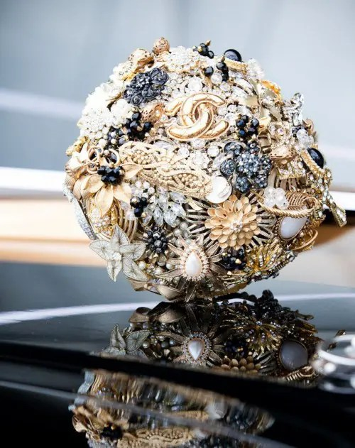 a sparkling brooch wedding bouquet done in black, white and gold