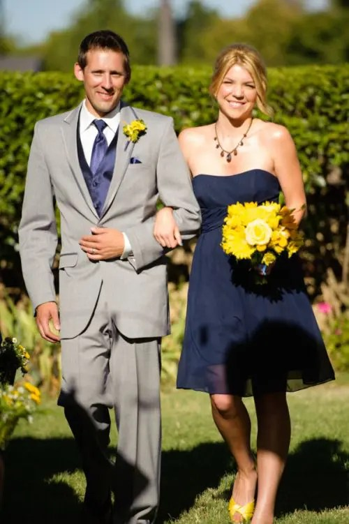 329ac646 a navy strapless bridesmaid dress, a grey suit with a navy tie and yellow  blooms