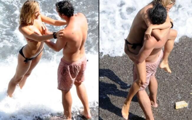 Mais um flagra da atriz inglesa Sienna Miller fazendo topless na Itália. Foto: Grosby Group