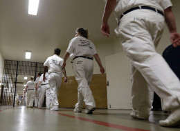 Inmates walk the halls in formation at Tutwiler Prison for Women in Wetumpka, Ala., Monday, Sept. 23, 2013. (AP Photo/Dave Martin)