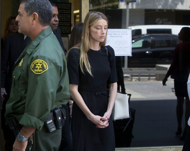 Amber Heard leaves court in LA after claiming Johnny Depp physically assaulted her