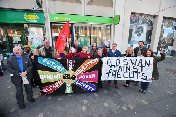 Protestors gathered outside the Jobcentre in Williamson Square to oppose the cuts implemented by the Government.<br /><br /><br /><br /><br /><br /> Photo by James Maloney