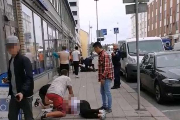 An injured victim lies at the scene of the attack in Turku, Finland
