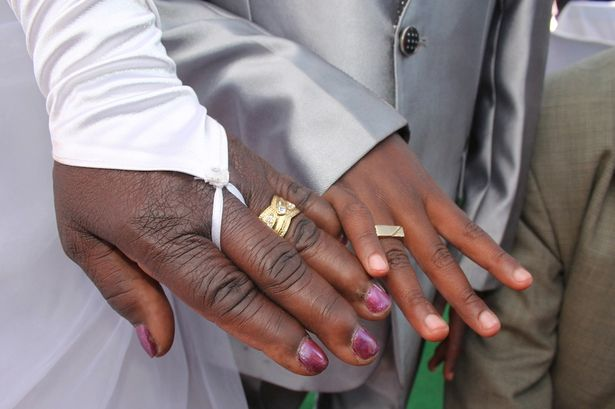 Bride Helen Shabangu (63) and her groom Sanele Masilela (9) showing the reporter their wedding rings at their second ritual marriage ceremony in Kildare Village, Ximhungwe near Bushbuckridge in Mpumalanga, South Africa.