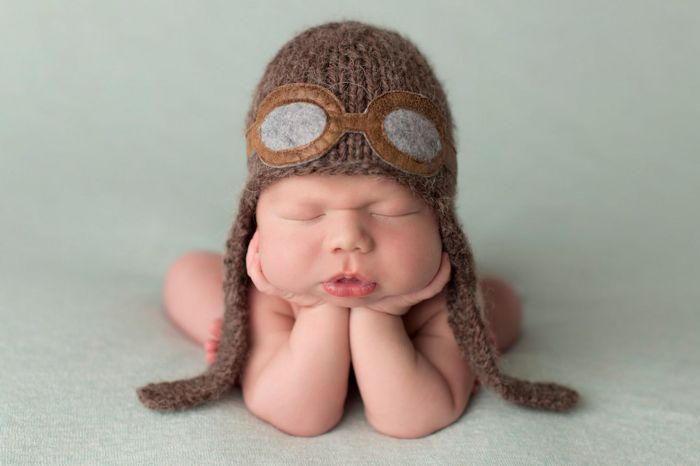 Newborn babies look gorgeous showing funny expressions and poses.