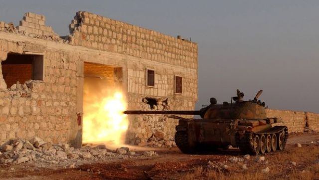 Syrian opposition brigades and members of Islamic Front stage attacks with tanks to the locations of Assad regime forces in north region of Aleppo, Syria